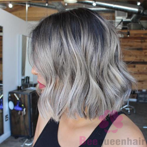 gray bob with darkened roots